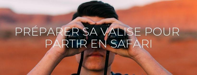 Jeune homme regardant à travers des jumelles- Article de blog post Que mettre dans sa valise pour safari